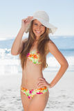 Young smiling woman in bikini standing with her hand on her hip Royalty Free Stock Photography