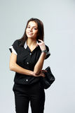 Young smiling woman in black formal clothes standing Royalty Free Stock Images
