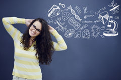 Young smiling woman on blue gray background with biology graphs. Stock Photography