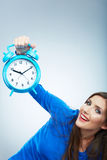 Young smiling woman in blue hold watch. Beautiful smiling girl Stock Photos
