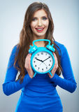 Young smiling woman in blue hold watch. Beautiful smiling girl Stock Image