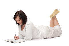 Young smiling woman with book and pen Royalty Free Stock Photos