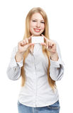 Young smiling woman with business card. Young smiling woman standing with business card in hands isolated on white background Stock Photography