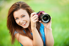 Young smiling woman with camera Royalty Free Stock Images
