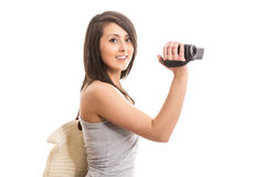 Young smiling woman with camera. Isolated Royalty Free Stock Photography