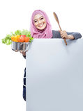 Young smiling woman carrying a pan full of vegetables and wooden Stock Images