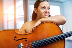Woman with a cello. Young smiling woman with a cello stock images