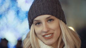 Young smiling woman at christmas market in a city. stock video