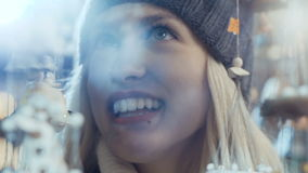 Young smiling woman at christmas market in a city. stock video footage