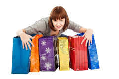 Young smiling woman with colored shopping bags Royalty Free Stock Photo
