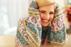 Young smiling woman in colourful sweater Stock Photo