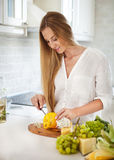 Young smiling woman cooking vegetables Royalty Free Stock Image