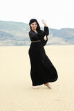 Young smiling woman dancing in desert Royalty Free Stock Photography