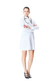 Young smiling woman doctor isolated on white Stock Photography