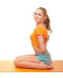 Young smiling woman doing gymnastic exercises. Isolated Royalty Free Stock Images