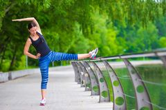 Young smiling woman doing sporty exercises Royalty Free Stock Photo