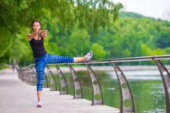 Young smiling woman doing sporty exercises Stock Image
