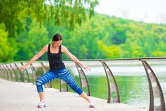 Young smiling woman doing sporty exercises Stock Images