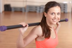 Young smiling woman doing stick exercises Stock Photo