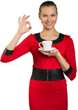 Young smiling woman drinking coffee Royalty Free Stock Photos