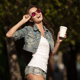 Young Smiling Woman Drinking Coffee To Go In A Park. Royalty Free Stock Photos