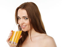 Young smiling woman drinking juice Stock Photos