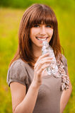 Young smiling woman drinking water Stock Image