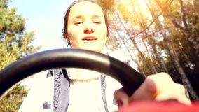 Young smiling woman driving ATV in the autumn park. 3840x2160 stock footage