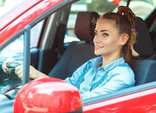 Young smiling woman driving the car Stock Images