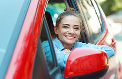 Young smiling woman driving the car Royalty Free Stock Photography