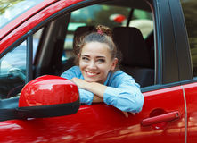 Young smiling woman driving the car Stock Image