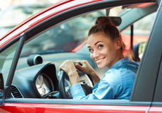 Young smiling woman driving the car Stock Photography