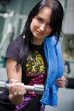 Young smiling woman with a dumbbell Royalty Free Stock Photos