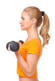 Young smiling woman with dumbbells Stock Photo