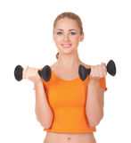 Young smiling woman with dumbbells Royalty Free Stock Image