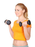 Young smiling woman with dumbbells Royalty Free Stock Photo