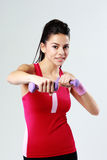 Young smiling woman with dumbbells working out Stock Images