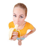 Young smiling woman eat banana Royalty Free Stock Image