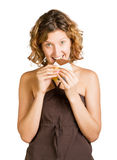 Young  smiling woman eating  chocolate Stock Photos