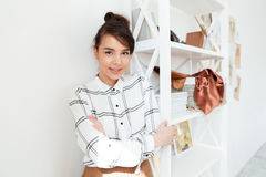 Young smiling woman fashion designer standing at her studio Royalty Free Stock Image