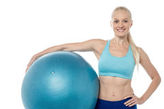 Young smiling woman with fitball Royalty Free Stock Photography