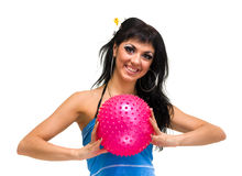Young smiling woman with fitness ball Royalty Free Stock Photos