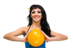 Young smiling woman with fitness ball Stock Image