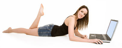 Young Smiling Woman on Floor Using Laptop Stock Photo