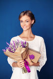 Young Smiling Woman with Flowers and Gift Stock Photos