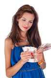 Young smiling woman with freckles holds cash Stock Photo