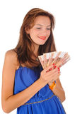 Young smiling woman with freckles holds cash Royalty Free Stock Photography