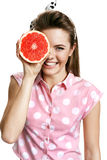 Young smiling woman with fresh juicy half of grapefruit, health and beauty care concept Stock Photos