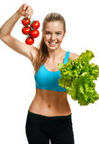 Young smiling woman with fresh tomatoes and lettuce, organic food, health and beauty care concept Stock Photography