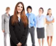 Young smiling woman in front of a group of people Royalty Free Stock Photos